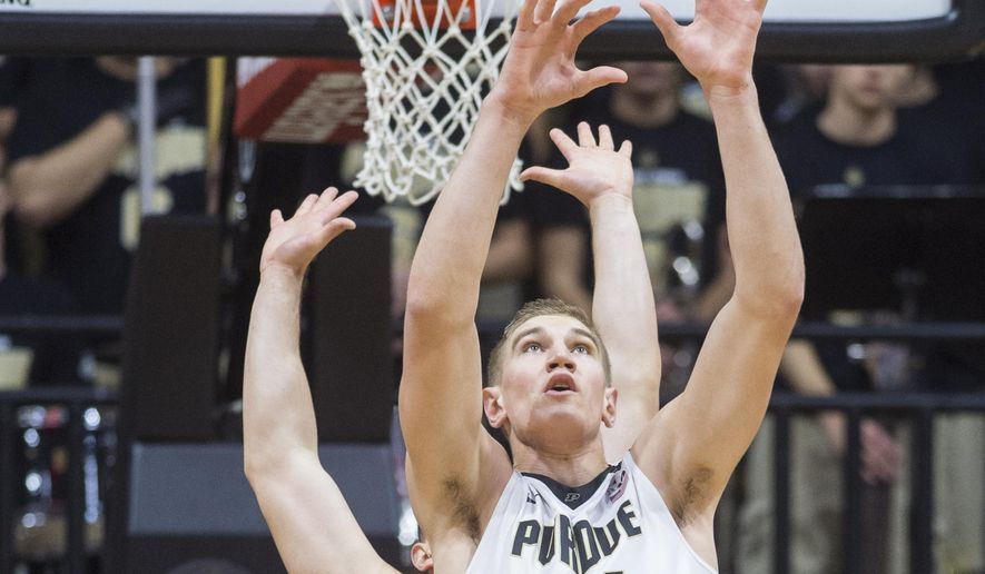 Purdue center Isaac Haas (44) receives a pass in the lane as he's defended by New Mexico center Nikola Scekic (33) during the first half of an NCAA college basketball game, Saturday, Dec. 5, 2015, in West Lafayette, Ind. (AP Photo/Doug McSchooler)