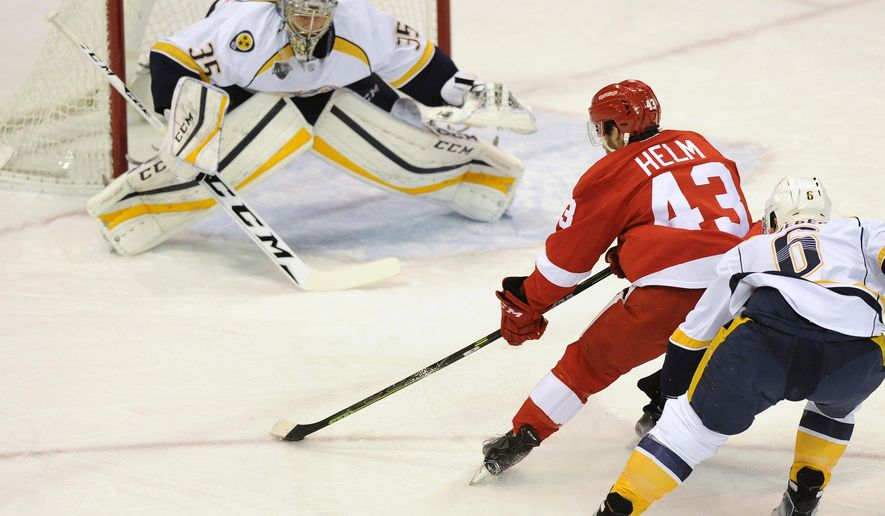 Detroit Red Wings center Darren Helm (43) skates with the puck as Nashville Predators goalie Pekka Rinne (35) prepares to block the shot and Predators defenseman Shea Weber (6) follows during the first period of an NHL hockey game in Detroit, Saturday, Dec. 5, 2015. (AP Photo/Jose Juarez)