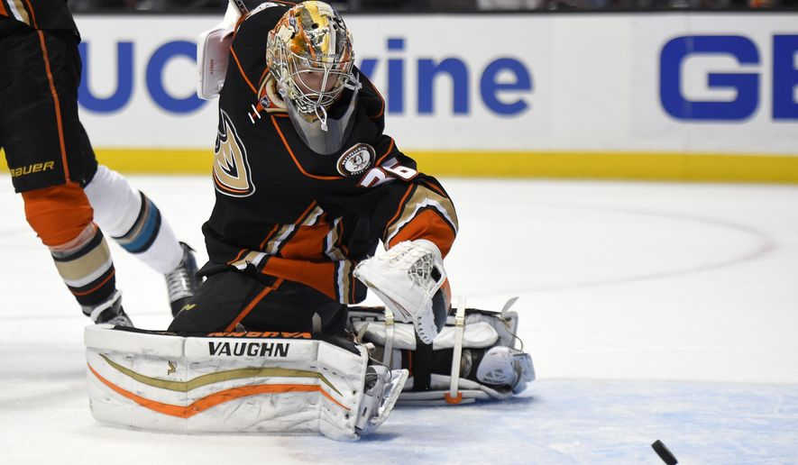 Anaheim Ducks goalie John Gibson watches a shot deflect away during the first period of an NHL hockey game against the San Jose Sharks, Friday, Dec. 4, 2015, in Anaheim, Calif. (AP Photo/Mark J. Terrill)