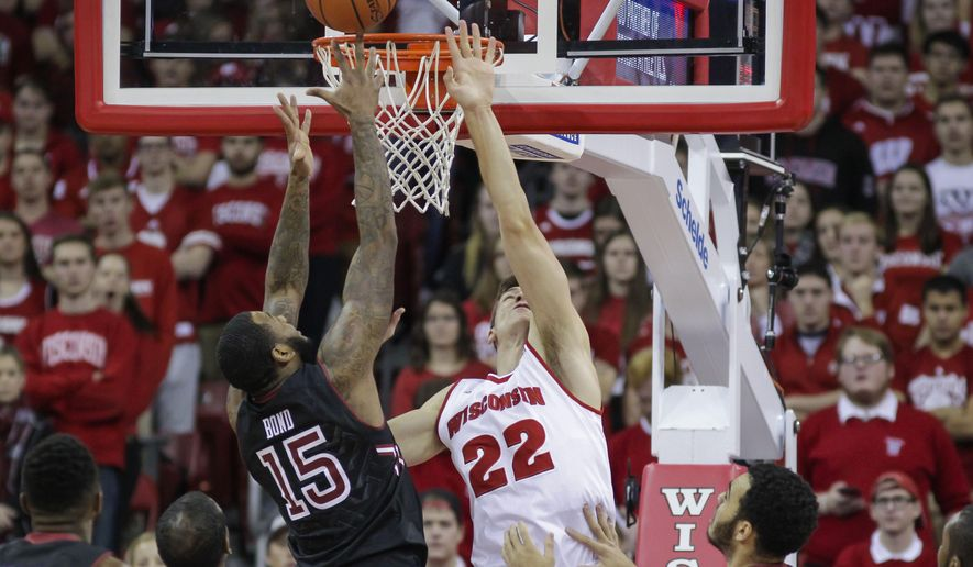 Temple's Jaylen Bond (15) and Wisconsin's Ethan Happ (22) go after a rebound during the first half of an NCAA college basketball game Saturday, Dec. 5, 2015, in Madison, Wis. (AP Photo/Andy Manis)