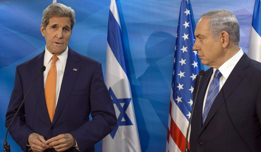FILE - In this Tuesday, Nov. 24, 2015 file photo, Israel's Prime Minister Benjamin Netanyahu, right, looks on as U.S. Secretary of State John Kerry speaks during a meeting at the Prime Minister's Office, in Jerusalem. On Saturday, Kerry warned Israel about the dangers of the possible collapse of the Palestinian Authority, saying it would lead to a situation that would threaten the security of Israel and the Palestinian people. (Atef Safadi/Pool via AP)