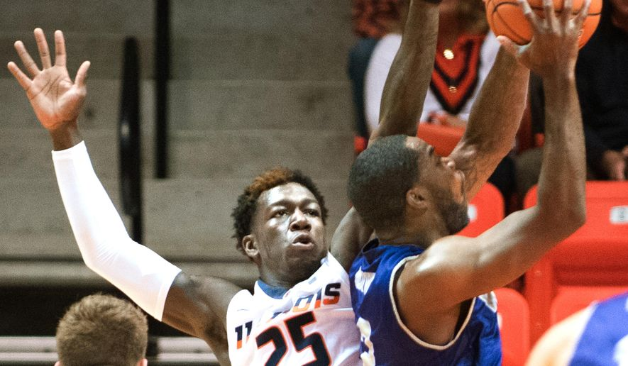 Illinois guard Kendrick Nunn (25) and Western Carolina guard Mike Brown (2) vie for the ball during an NCAA college basketball game in Champaign, Ill., Saturday, Dec. 5, 2015. Illinois won 80-68. (AP Photo/Robin Scholz)