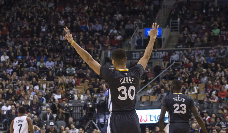Golden State Warriors' Stephen Curry celebrates after teammate Jason Thompson scores a three point shot against the Toronto Raptors during the first half of an NBA basketball game in Toronto, Saturday, Dec. 5, 2015. (Chris Young/The Canadian Press via AP) MANDATORY CREDIT