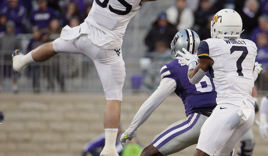 West Virginia linebacker Nick Kwiatkoski (35) intercepts a pass intended for Kansas State wide receiver Deante Burton (6) during the first half of an NCAA college football game Saturday, Dec. 5, 2015, in Manhattan, Kan. (AP Photo/Charlie Riedel)
