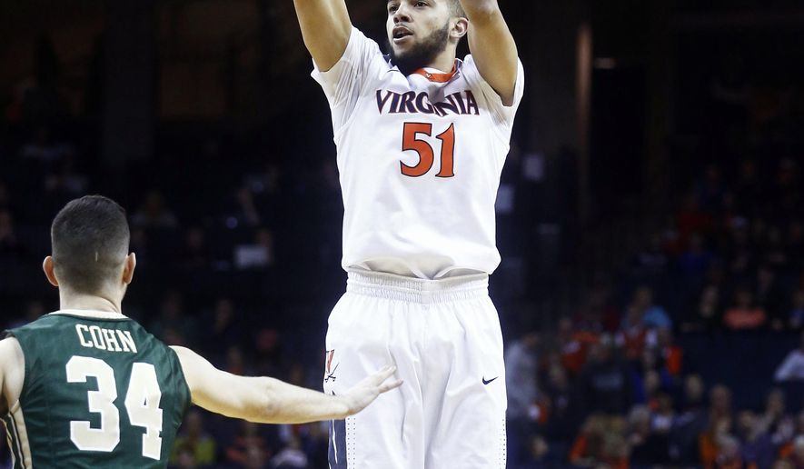 Virginia guard Darius Thompson (51) shoots during the first half of an NCAA college basketball game against William & Mary in Charlottesville, Va., on Saturday, Dec. 5, 2015. (AP Photo/Ryan M. Kelly)