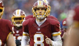"""In this photo taken Nov. 29, 2015, Washington Redskins quarterback Kirk Cousins (8) runs off the field at halftime during an NFL football game against the New York Giants in Landover, Md. Without a trace of irony or attempt at humor, Cousins recounted his thoughts from a decade or so ago when discussing the significance of his upcoming start against the Dallas Cowboys on """"Monday Night Football."""" (AP Photo/Patrick Semansky)"""