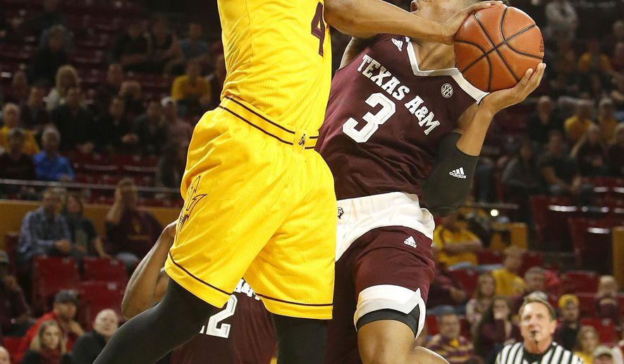 Texas A&M guard Admon Gilder (3) drives against Arizona State guard Gerry Blakes  during the first half of an NCAA college basketball game, Saturday, Dec. 5, 2015, in Tempe, Ariz. (AP Photo/Rick Scuteri)