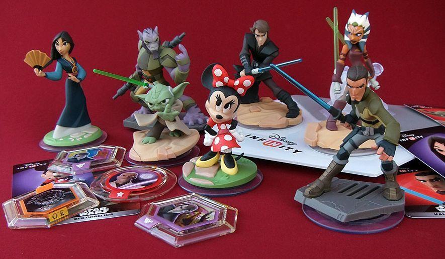 Figures of Mulan, Zeb Orrelios, Yoda, Minnie Mouse, Anakin Skywalker, Ahsoka Tano and Kanan Jarrus co-star in Disney Infinity 3.0 viode game universe. (Photograph by Joseph Szadkowski / The Washington Times)