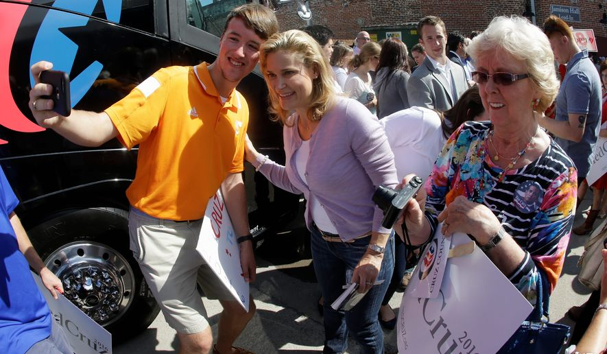 Heidi Cruz (center), wife of Republican presidential candidate Sen. Ted Cruz, has been a powerful and crucial behind-the-scenes asset for her husband's campaign, often putting in 18-hour days. (Associated Press)