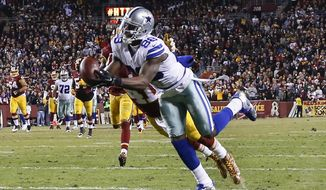 Dallas Cowboys wide receiver Dez Bryant (88) pulls in a pass under pressure from Washington Redskins cornerback Will Blackmon (41) during the second half of an NFL football game in Landover, Md., Monday, Dec. 7, 2015. (AP Photo/Alex Brandon)
