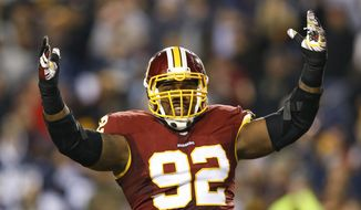 Washington Redskins defensive end Chris Baker (92) reacts to a play during the second half of an NFL football game against the Dallas Cowboys in Landover, Md., Monday, Dec. 7, 2015. (AP Photo/Patrick Semansky)