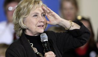 "In this Friday, Dec. 4, 2015, file photo, Democratic presidential candidate Hillary Clinton speaks during a town hall meeting in Fort Dodge, Iowa. Clinton will unveil a proposal for a new ""exit tax"" on Wednesday, Dec. 9, aimed at cracking down on corporate inversions, in which U.S. companies merge with corporations overseas in an effort to lower their tax bill. (AP Photo/Charlie Neibergall, File)"