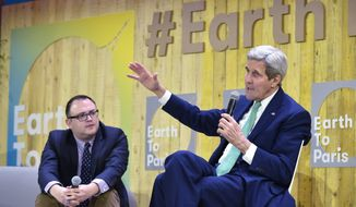 "US Secretary of State John Kerry, right, gestures as he speaks, flanked by Mashable science editor Andrew Freedman, at the Mashable/UN Foundation ""Earth to Paris"" summit at Le Petit Palais in Paris, France, on the sidelines of the COP21, the UN climate change conference, Monday, Dec. 7, 2015. (Mandel Ngan/Pool Photo via AP)"