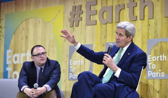 """US Secretary of State John Kerry, right, gestures as he speaks, flanked by Mashable science editor Andrew Freedman, at the Mashable/UN Foundation """"Earth to Paris"""" summit at Le Petit Palais in Paris, France, on the sidelines of the COP21, the UN climate change conference, Monday, Dec. 7, 2015. (Mandel Ngan/Pool Photo via AP)"""