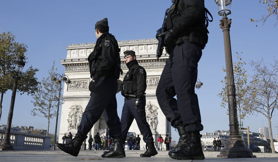 French gendarmes officers patrol on the Champs Elysees, in Paris, in this Nov. 23, 2015, file photo. Security has been on high alert in the French capital, after the attacks in Paris on Nov. 13, which killed 130 people. (AP Photo/Laurent Cipriani, File)