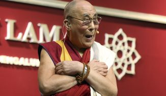Tibetan spiritual leader, the Dalai Lama, laughs while interacting with the audience after delivering a speech at National Institute of Mental Health and Neurosciences in Bangalore, India, Monday, Dec. 7, 2015. (AP Photo/Aijaz Rahi)