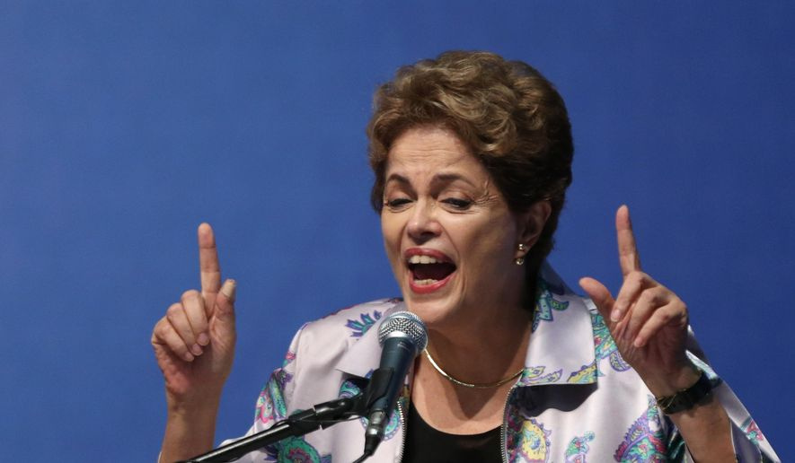 Brazil's President Dilma Rousseff speaks about the impeachment proceedings against her while addressing an audience at the National Health Conference, in Brasilia, Brazil, Friday, Dec. 4, 2015. Justices at the Supreme Court rejected Friday, two appeals to halt impeachment proceedings against her, one lodged by Rousseff's own Workers' Party, and another by the Brazilian Communist Party. One appeal remains before the court. (AP Photo/Eraldo Peres)