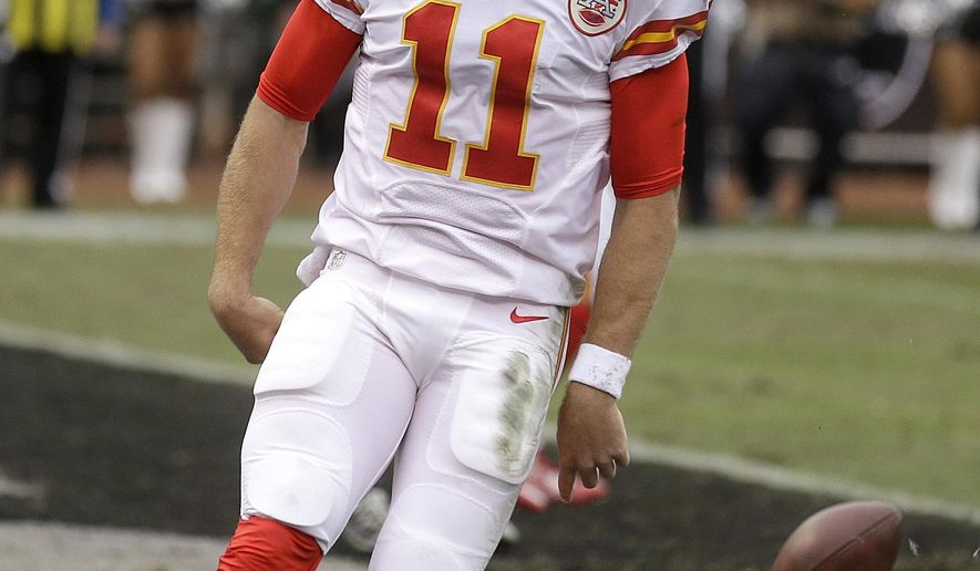 Kansas City Chiefs quarterback Alex Smith (11) reacts after running for a touchdown against the Oakland Raiders during the first half of an NFL football game in Oakland, Calif., Sunday, Dec. 6, 2015. (AP Photo/Ben Margot)