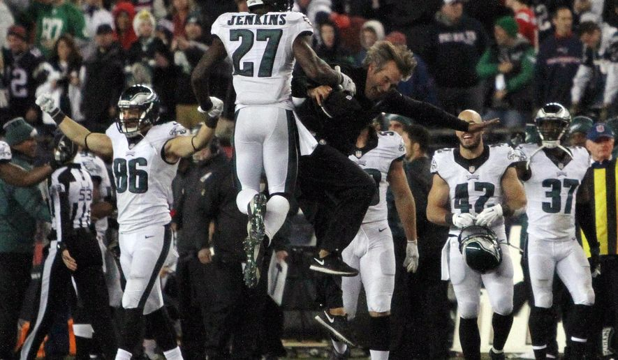 The Philadelphia Eagles celebrate their 35-28 win over the New England Patriots in an NFL football game, Sunday, Dec. 6, 2015, in Foxborough, Mass. (AP Photo/Bill Sikes)