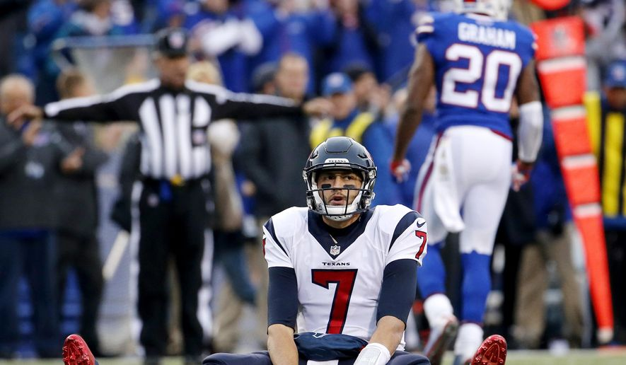 Houston Texans quarterback Brian Hoyer is slow to get up after being hit by Buffalo Bills free safety Corey Graham, back right, as he threw a pass during the second half of an NFL football game, Sunday, Dec. 6, 2015, in Orchard Park, N.Y. (AP Photo/Bill Wippert)