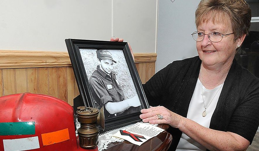 ADVANCE FOR MONDAY DEC 7 AMD THEREAFTER - This Dec. 1, 2015  photo shows Jeanette Webb, of Glen White, W.Va., as she looks over a picture of her coal mining son, Steven James Webb, who passed away Oct. 27, 2013. She released a helium balloon on Thanksgiving night in memory of her son.  The balloon made a 3,716-mile journey and was found in Cornwall, United Kingdom.  (Rick Barbero/The Register-Herald via AP)