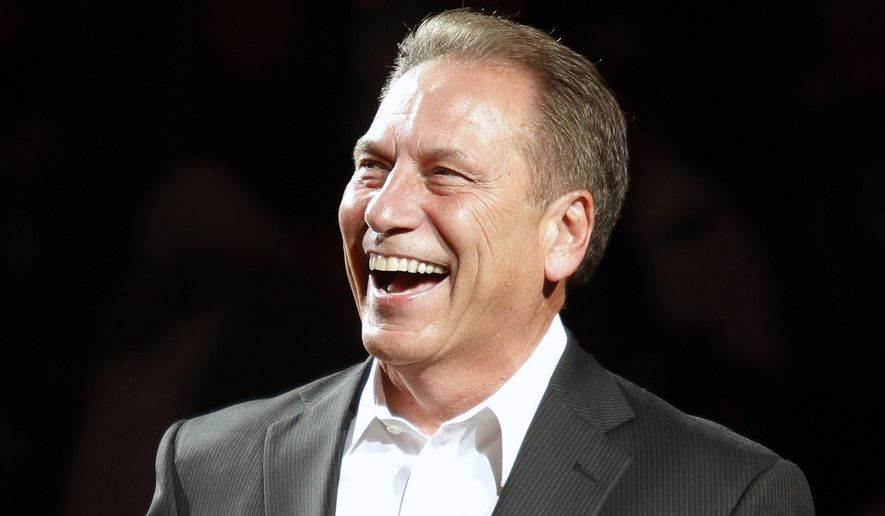 FILE - In this Oct. 23, 2015, file photo, Michigan State coach Tom Izzo smiles before an NCAA college basketball scrimmage, in East Lansing, Mich. Michigan State is No. 1 in The Associated Press men's college basketball poll for the first time since early in the 2013-14 season. (AP Photo/Al Goldis, File)