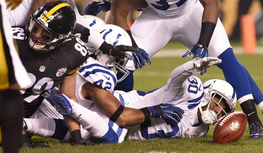 Indianapolis Colts cornerback D'Joun Smith (30) recovers a fumble on the opening kick off by Pittsburgh Steelers'  Jacoby Jones (13) during the first half of an NFL football game, Sunday, Dec. 6, 2015, in Pittsburgh. (AP Photo/Don Wright)