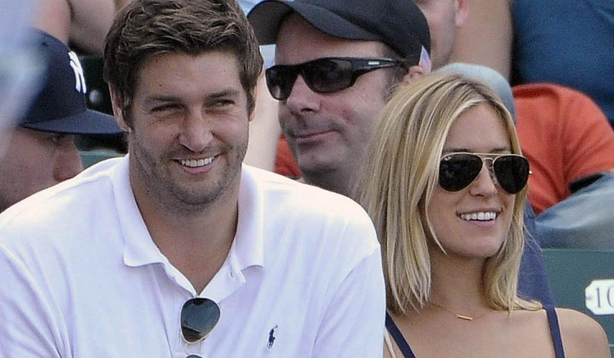 FILE - In this July 2, 2011, file photo, Chicago Bears quarterback Jay Cutler, left, and his wife Kristin Cavallari watch the Chicago Cubs play the Chicago White Sox during an interleague baseball game in Chicago. Utah authorities say the brother-in-law of Cutler has been missing for more than a week after his abandoned car was found running on a remote dirt road with the air bag deployed. Grand County Sheriff Steven White said Monday that a rancher discovered 30-year-old Michael Cavallari's car early on Nov. 27, the day after Thanksgiving. It was found about 200 miles south of Salt Lake City and 5 miles south of Interstate 70. (AP Photo/Brian Kersey, File)