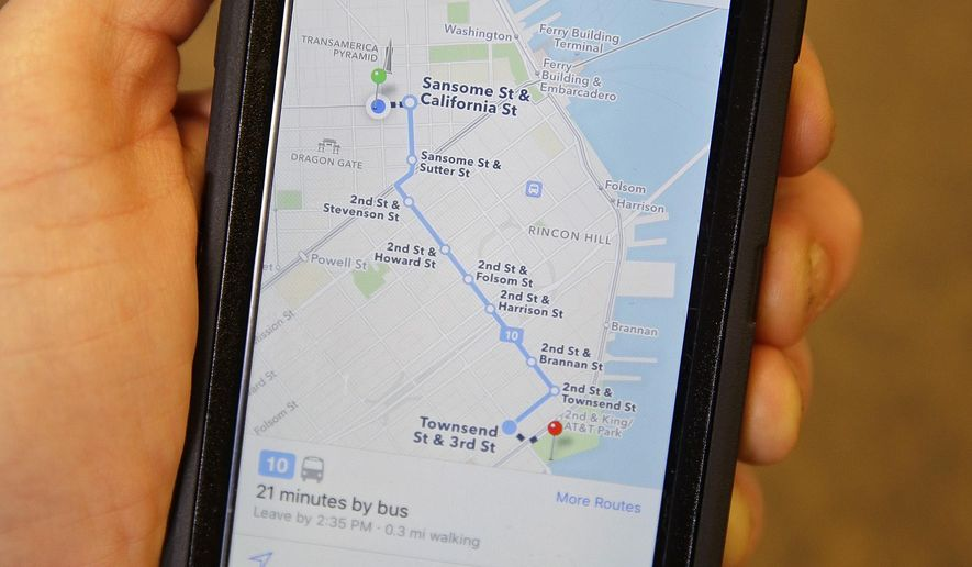 In this photo taken Friday, Dec. 4, 2015, the Apple Maps app displays transit directions in San Francisco. Apple, Google and several smaller companies all help you get from point A to B via public transit. (AP Photo/Eric Risberg)