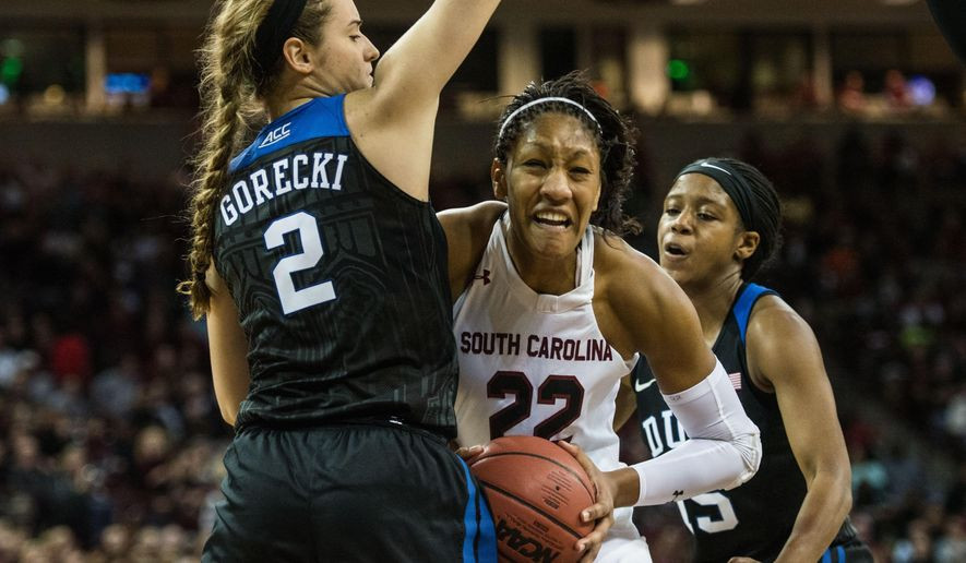 South Carolina forward A'ja Wilson (22) drives to the basket against Duke guard Haley Gorecki (2) during the first half of an NCAA college basketball game Sunday, Dec. 6, 2015, in Columbia, S.C. (AP Photo/Sean Rayford)