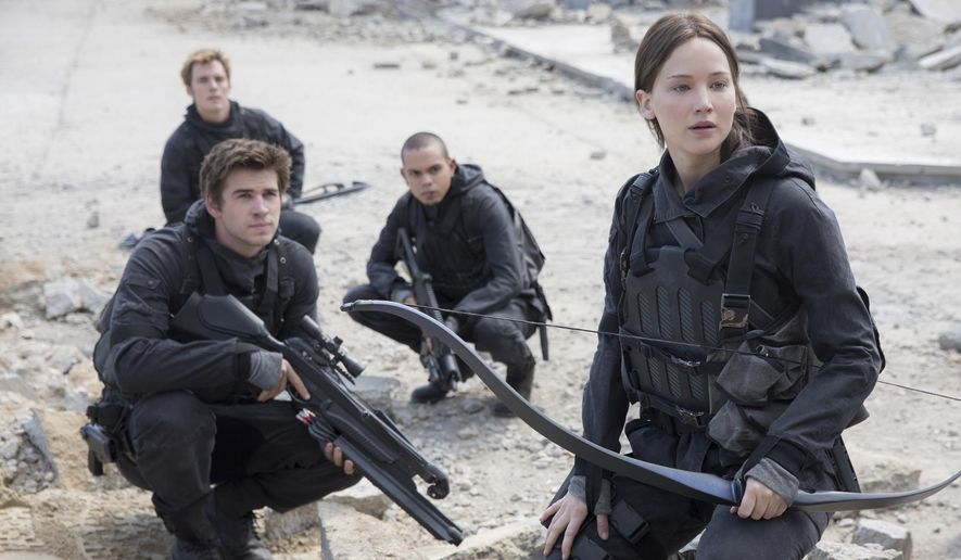 "This photo provided by Lionsgate shows, Liam Hemsworth, left, as Gale Hawthorne, Sam Clafin, back left, as Finnick Odair, Evan Ross, back right, as Messalia, and Jennifer Lawrence, right, as Katniss Everdeen, in the film, ""The Hunger Games: Mockingjay - Part 2.""  The movie opened in U.S. theaters on Nov. 20, 2015. (Murray Close/Lionsgate via AP)"