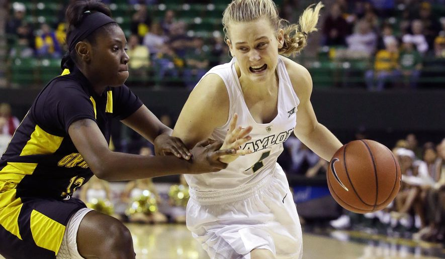 Baylor Kristy Wallace, right, drives against Grambling State guard Jazmine Boyd (13) during the first half of an NCAA college basketball game Sunday, Dec. 6, 2015, in Waco, Texas. (AP Photo/LM Otero)