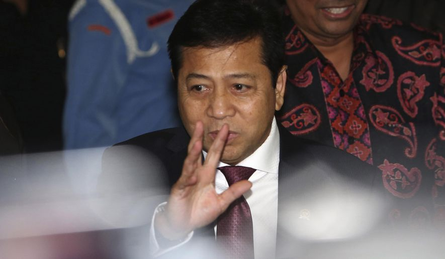 Indonesian House Speaker Setya Novanto waves at reporters as he leaves after attending the Parliament's Ethics Council hearing in Jakarta, Indonesia, Monday, Dec. 7, 2015. Novanto of the opposition Golkar Party is under public scrutiny because of allegations that he and a businessman ally used the names of President Joko Widodo and Vice President Jusuf Kalla to seek a 20 percent share from PT Freeport Indonesia, a subsidiary of the Phoenix, Arizona-based Freeport-McMoRan Copper & Gold Inc. which runs a giant gold and copper mine in Papua province. (AP Photo/Tatan Syuflana)