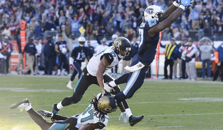Tennessee Titans wide receiver Dorial Green-Beckham (17) gets past Jacksonville Jaguars defenders Johnathan Cyprien (37) and Dwayne Gratz (27) as Green-Beckham scores a touchdown on a 47-yard pass play in the second half of an NFL football game Sunday, Dec. 6, 2015, in Nashville, Tenn. (AP Photo/Mark Zaleski)