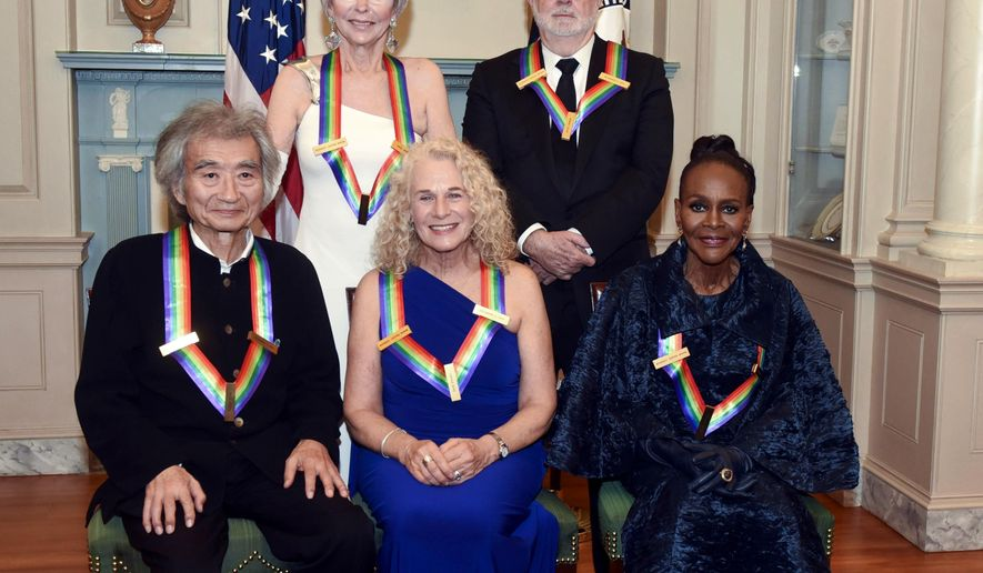The 2015 Kennedy Center Honorees, from left, Seiji Ozawa, Rita Moreno, Carole King, George Lucas and Cicely Tyson pose for a group photo following the State Department Dinner for the Kennedy Center Honors on Saturday, Dec. 5, 2015, in Washington. (AP Photo/Kevin Wolf)