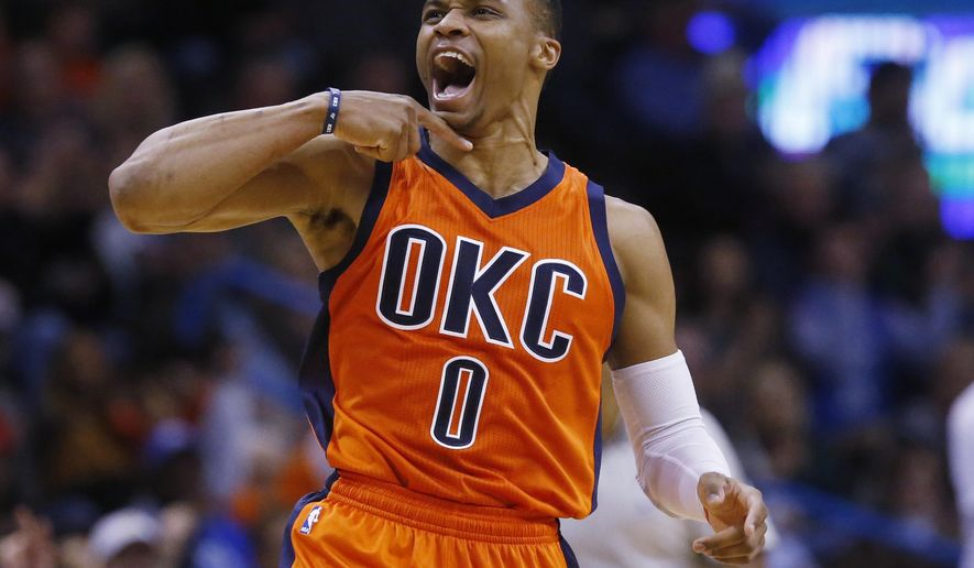 Oklahoma City Thunder guard Russell Westbrook (0) gestures in the second quarter of an NBA basketball game against the Sacramento Kings in Oklahoma City, Sunday, Dec. 6, 2015. (AP Photo/Sue Ogrocki)