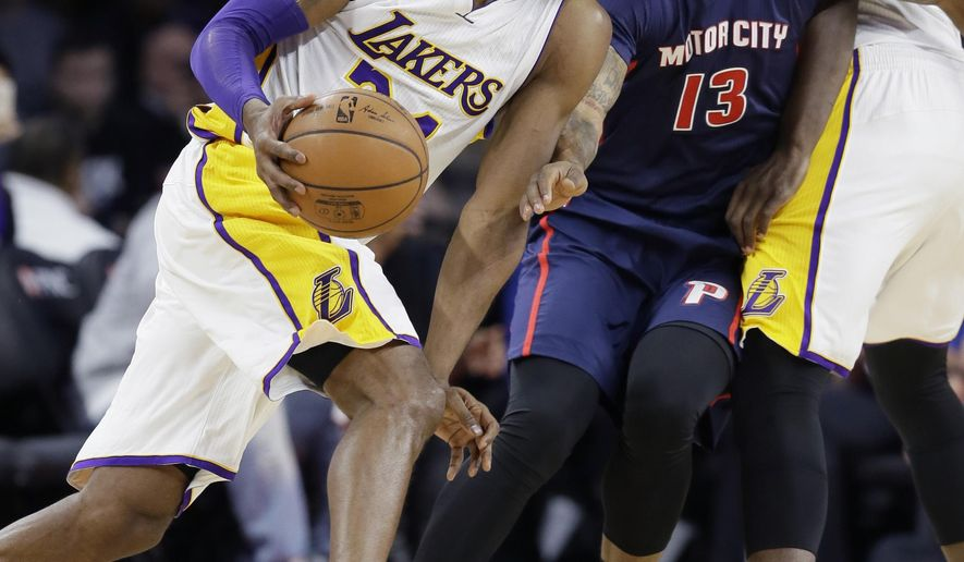 Los Angeles Lakers forward Kobe Bryant, left, drives around Detroit Pistons forward Marcus Morris (13) during the first half of an NBA basketball game, Sunday, Dec. 6, 2015, in Auburn Hills, Mich. (AP Photo/Carlos Osorio)