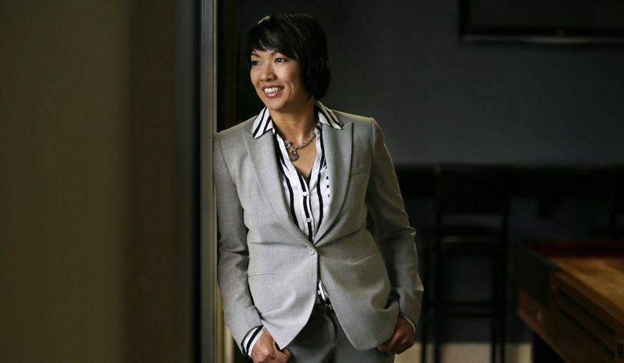 Nikki Nguyen poses for a photo, Thursday, Dec. 3, 2015, in Santa Ana, Calif. The 34-year-old law school graduate is among 12 former Thomas Jefferson students suing the university, accusing it of inflating its graduates' employment figures and salaries to attract students. (AP Photo/Jae C. Hong)