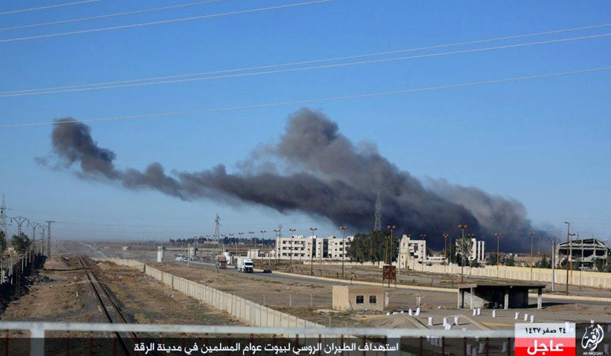 """This image posted online Sunday, Dec. 6, 2015, by supporters of the Islamic State militant group on an anonymous photo sharing website, shows smoke rising in the aftermath of an airstrike that targeted areas in Raqqa, Syria. The photo bears the watermark of Islamic State media releases and is consistent with other AP reporting. The Arabic caption on the photo reads, """"Russian warplanes target homes of Muslims in Raqqa."""" (militant photo via AP) ** FILE **"""