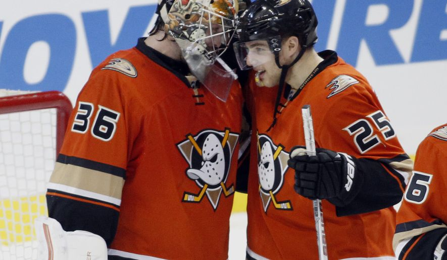 Anaheim Ducks center Mike Santorelli (25) congratulates goalie John Gibson (36) after defeating the Pittsburgh Penguins 2-1 in an NHL hockey game in Anaheim, Calif., Sunday, Dec. 6, 2015.   (AP Photo/Alex Gallardo)