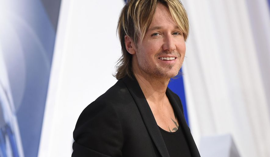 FILE - In a Wednesday, Nov. 4, 2015 file photo, Keith Urban arrives at the 49th annual CMA Awards at the Bridgestone Arena, in Nashville, Tenn. Urban is mourning the death of his father, Bob Urban, at the age of 73. Urban said in a statement released late Sunday, Dec. 6, 2015,  that his dad died on Saturday after a long battle with cancer. (Photo by Evan Agostini/Invision/AP)