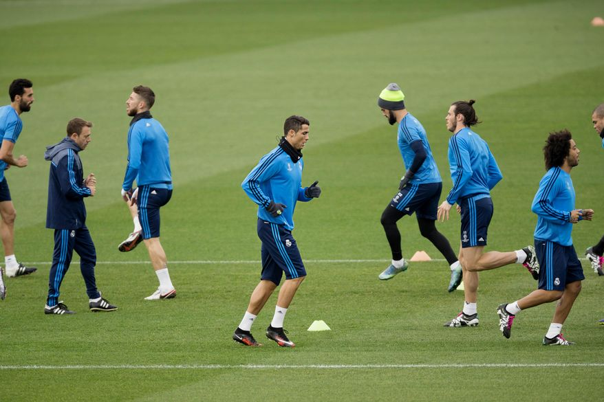 Real Madrid's Cristiano Ronaldo, center, runs with teammates during a training session in Valdebebas stadium in Madrid, Spain, Monday, Dec. 7, 2015. Real Madrid will face Malmo FF in a Champion's League Group A soccer match on Tuesday. (AP Photo/Daniel Ochoa de Olza)