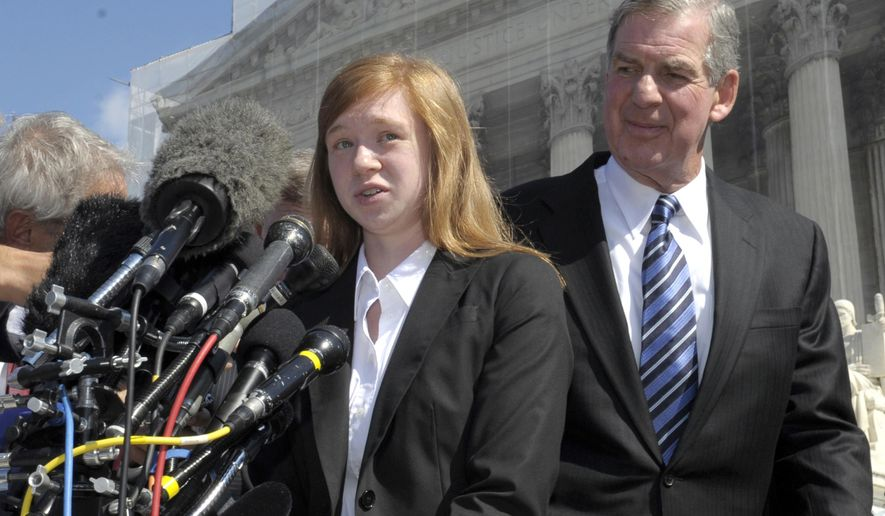 FILE - In this Oct. 10, 2012, file photo, Abigail Fisher, the Texan involved in the University of Texas affirmative action case, accompanied by her attorney Bert Rein, talks to reporters outside the Supreme Court in Washington. Consideration of race in college admissions is again in line of fire at the Supreme Court on Wednesday, Dec. 9, 2015, for the second time in three years, in the case of Fisher, a white Texas woman who was rejected for admission at the University of Texas. (AP Photo/Susan Walsh)