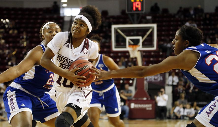 Mississippi State guard Jazzmun Holmes (10) attempts a layup past Tennessee State defenders in the first half of an NCAA college basketball game in Starkville, Miss., Sunday, Dec. 6, 2015. (AP Photo/Rogelio V. Solis)