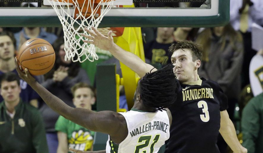 Baylor forward Taurean Prince (21) drives to the basket against Vanderbilt forward Luke Kornet (3) during an NCAA college basketball game Sunday, Dec. 6, 2015, in Waco, Texas. (AP Photo/LM Otero)