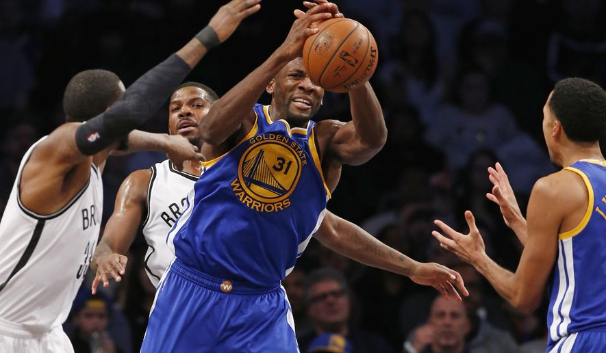 Brooklyn Nets forward Willie Reed, left, and forward Joe Johnson, defend Golden State Warriors center Festus Ezeli (31) as he loses the ball in the first half of an NBA basketball game, Sunday, Dec. 6, 2015, in New York. (AP Photo/Kathy Willens)
