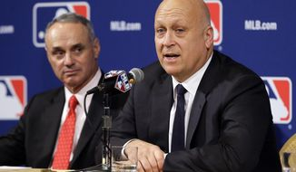 Former Baltimore Orioles shortstop and member of the Hall of Fame Cal Ripken Jr., right, speaks with Major League Baseball Commissioner Robert D. Manfred, Jr., left, at the MLB winter meetings, Monday, Dec. 7, 2015, in Nashville, Tenn. (AP Photo/Mark Humphrey)