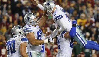 Dallas Cowboys kicker Dan Bailey (5) celebrates with his teammates after kicking the game-winning field goal during the second half of an NFL football game against the Washington Redskins in Landover, Md., Monday, Dec. 7, 2015. The Cowboy defeated the Redskins 19-16. (AP Photo/Alex Brandon)