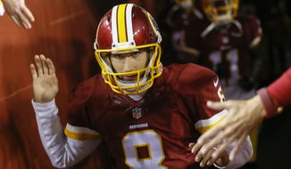 Washington Redskins quarterback Kirk Cousins (8) runs on to the field to warm up before an NFL football game against the Dallas Cowboys in Landover, Md., Monday, Dec. 7, 2015. (AP Photo/Patrick Semansky)
