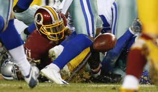 Washington Redskins wide receiver DeSean Jackson (11) fumbles the ball on a kickoff return setting up a Dallas Cowboys touchdown during the second half of an NFL football game in Landover, Md., Monday, Dec. 7, 2015. The Cowboys defeated the Redskins 19-16. (AP Photo/Alex Brandon)